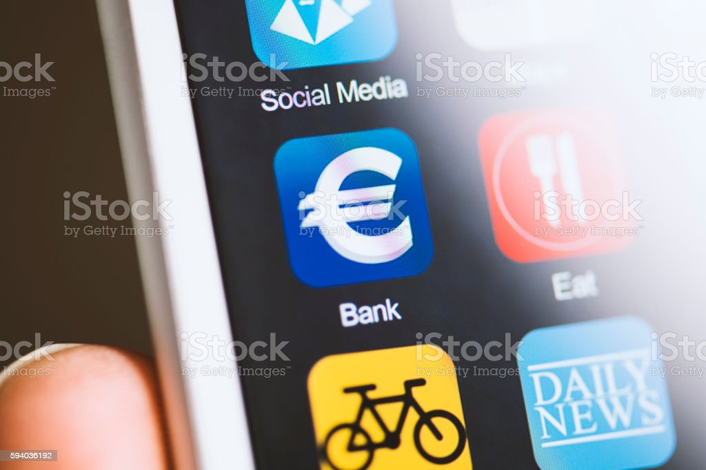 Hand holding smart phone, banking application with euro sign on screen