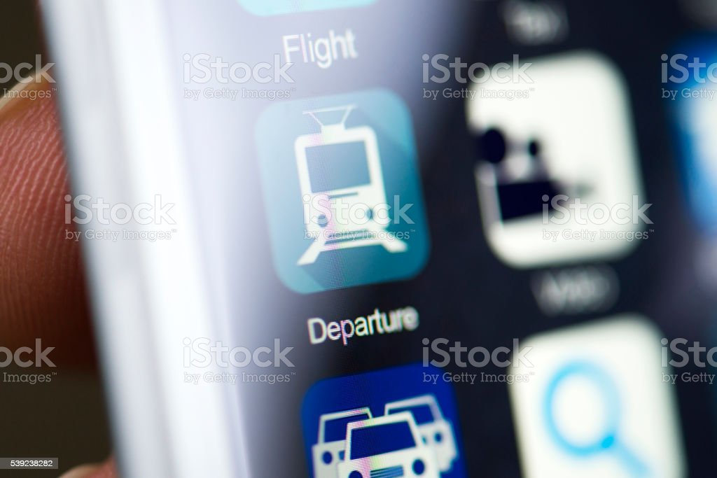 Hand holding phone, departure app on screen royalty-free stock photo