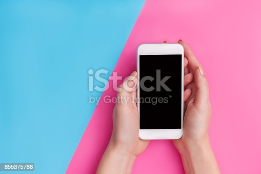 534217898istockphoto hand holding phone isolated on white clipping path inside 855375766