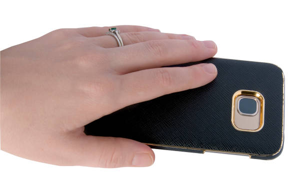 Hand Holding Phone Female hand holding a smart phone with a case  on it. face down stock pictures, royalty-free photos & images