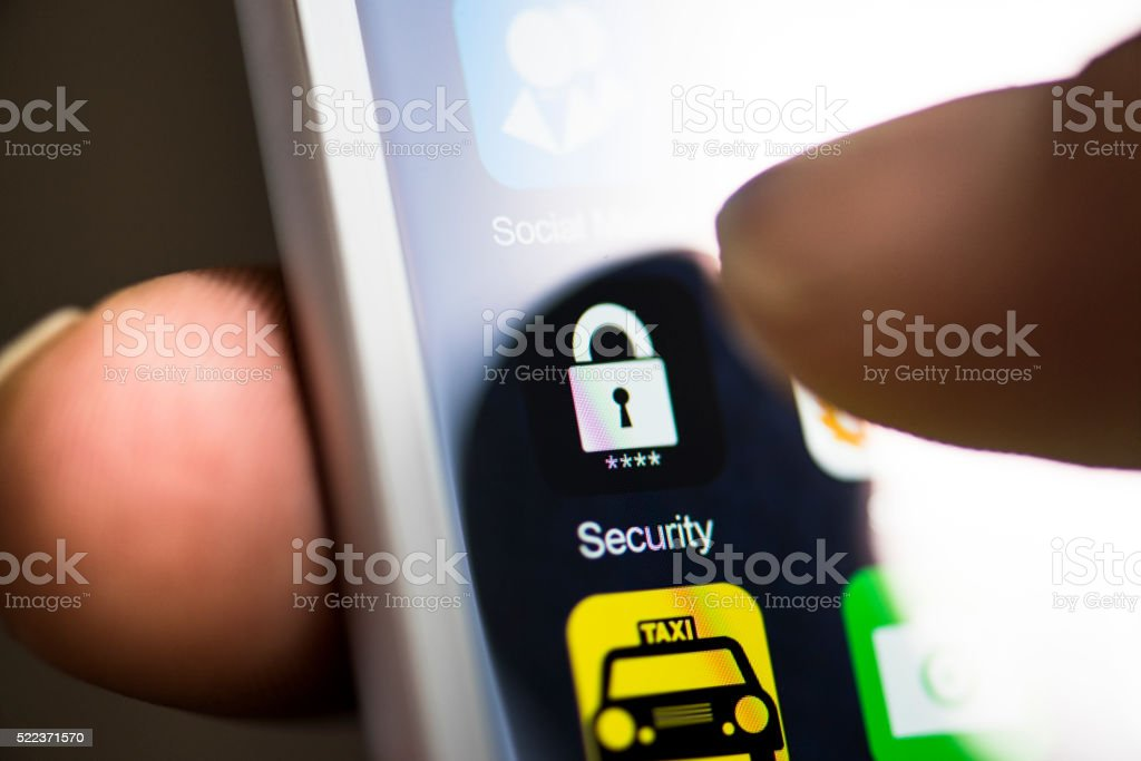 Hand holding phone, security app on screen stock photo