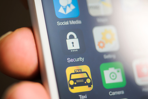 Hand Holding Phone Security App On Screen Stock Photo - Download Image Now
