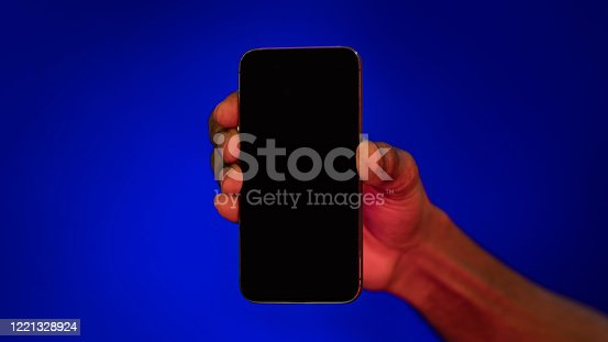 istock Hand Holding Phone With Blank Screen Over Blue Background, Panorama 1221328924