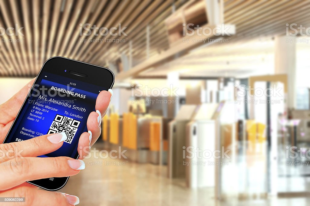 hand holding phone with mobile boarding pass stock photo