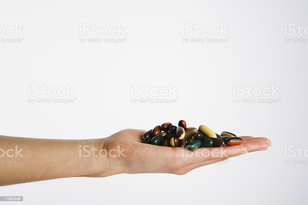 Hand holding pile of pills royalty-free stock photo
