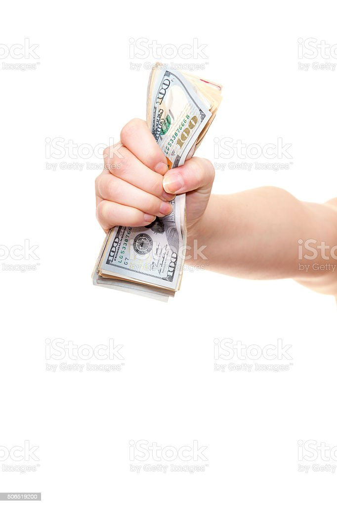 Hand holding pile of us dollar notes stock photo