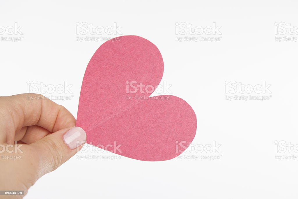 Hand Holding PInk Cut Out Heart stock photo