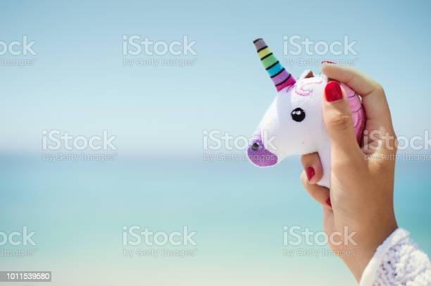 Hand holding pink trendy unicorn on blue sky background empty space picture id1011539580?b=1&k=6&m=1011539580&s=612x612&h=u04tw4wfxojqxn9zwjuo9zvfjb2gtm2sr7rn0pocf e=