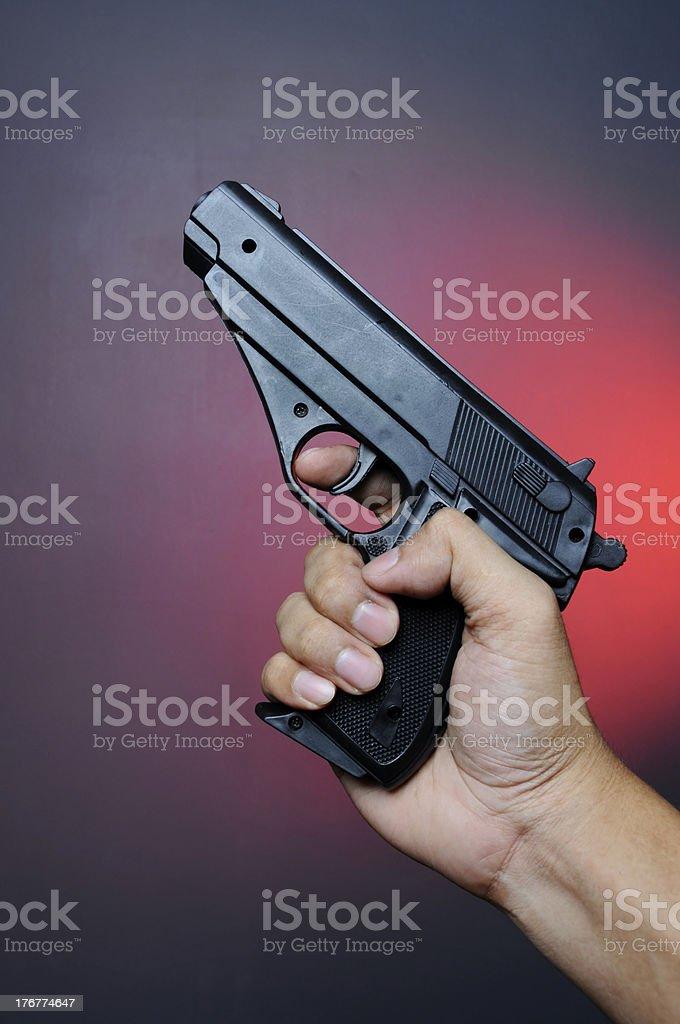 Hand holding pistol royalty-free stock photo