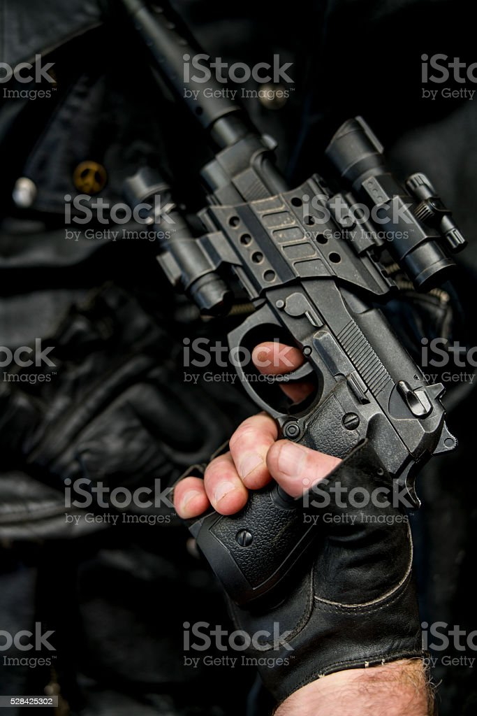 hand holding pistol pointing up stock photo