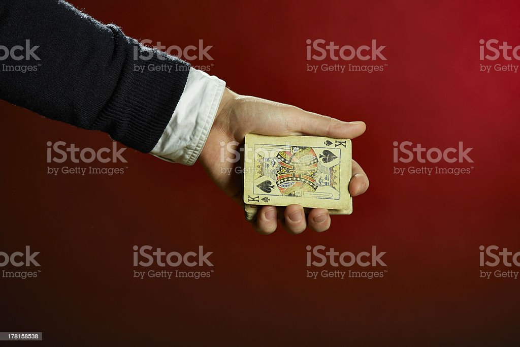 Hand holding playing cards royalty-free stock photo