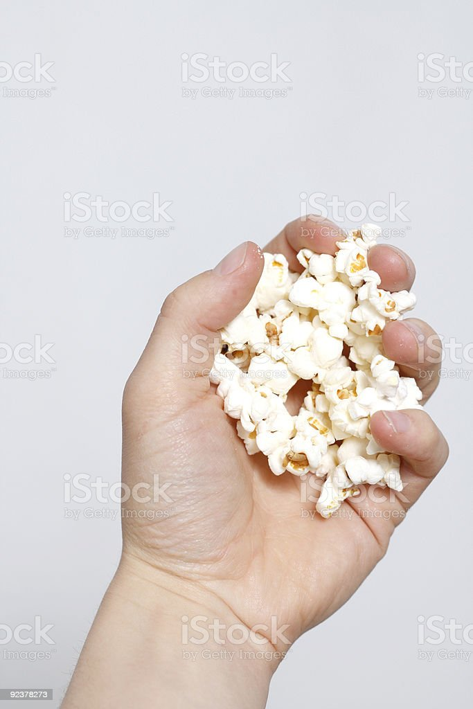 Hand holding popcorn royalty-free stock photo
