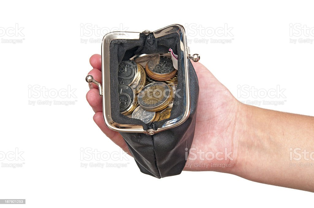 Hand holding purse with coins royalty-free stock photo