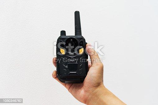 Hand holding radiotelephone walkie talkie