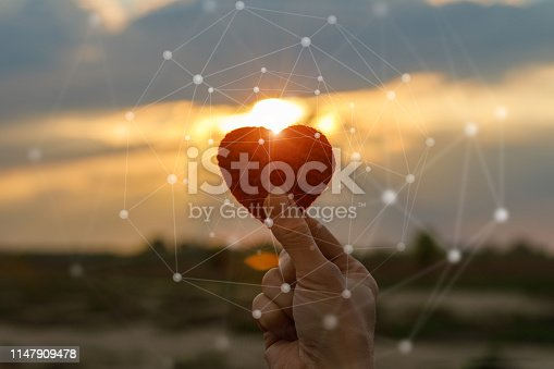 istock Hand holding red knit heart . 1147909478