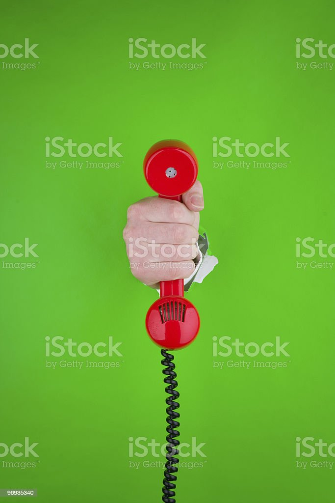 Hand holding red telephone royalty-free stock photo