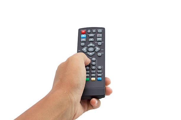 hand holding remote control isolated on white background hand holding remote control isolated on white background - clipping paths. remote control stock pictures, royalty-free photos & images