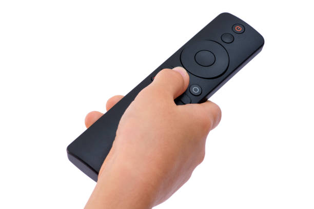 Hand holding remote control isolated stock photo stock photo