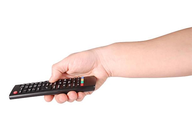 hand holding remote control (clipping path) - cut video transition стоковые фото и изображения