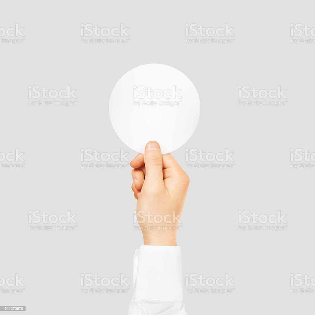 Hand holding round blank white sticker mock up isolated on stock image