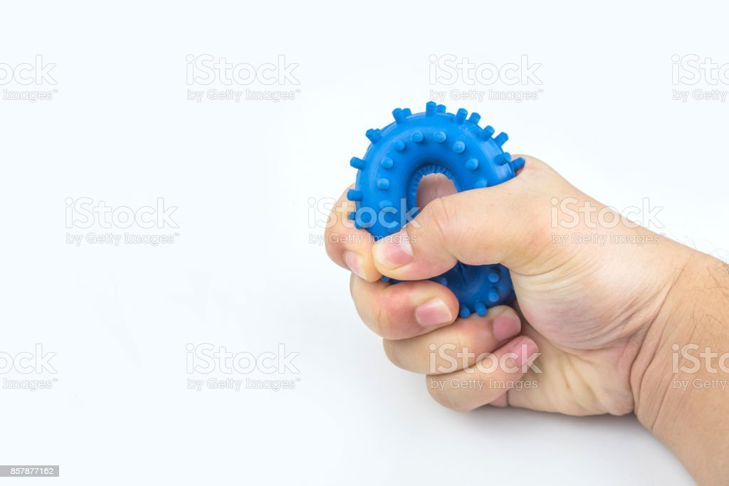 Hand Holding Rubber Ring Trainer stock photo
