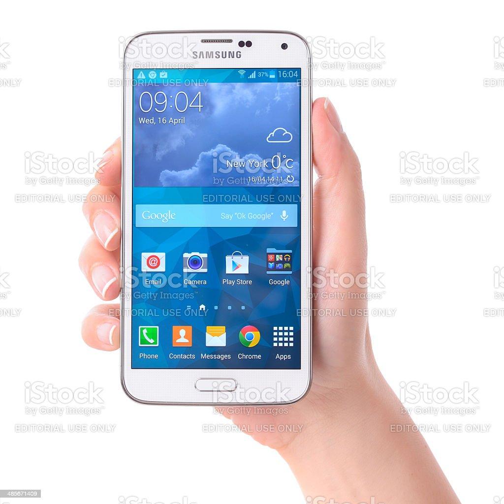Hand holding Samsung Galaxy S5 stock photo