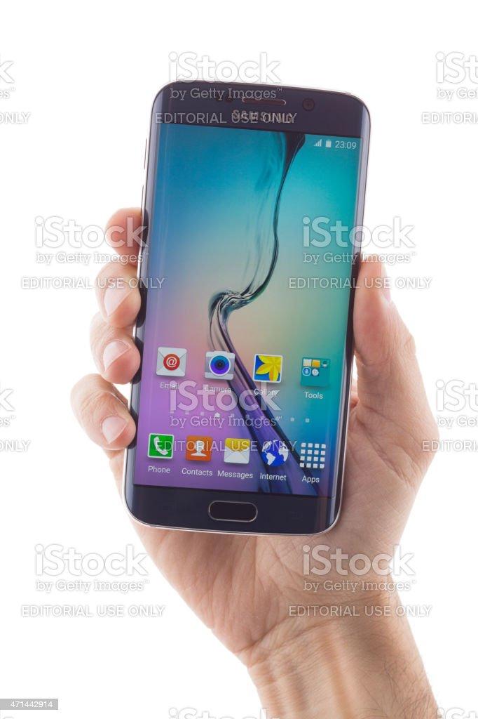 Hand holding Samsung Galaxy S6 EDGE stock photo