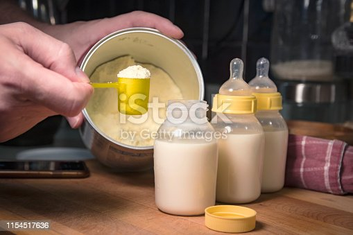 measuring the powder for baby's nourishment