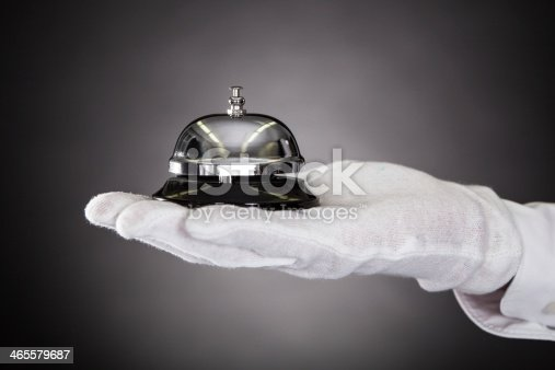 840883328istockphoto Hand Holding Service Bell 465579687