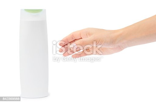 istock Hand holding shampoo bottle isolated on white background 842369588