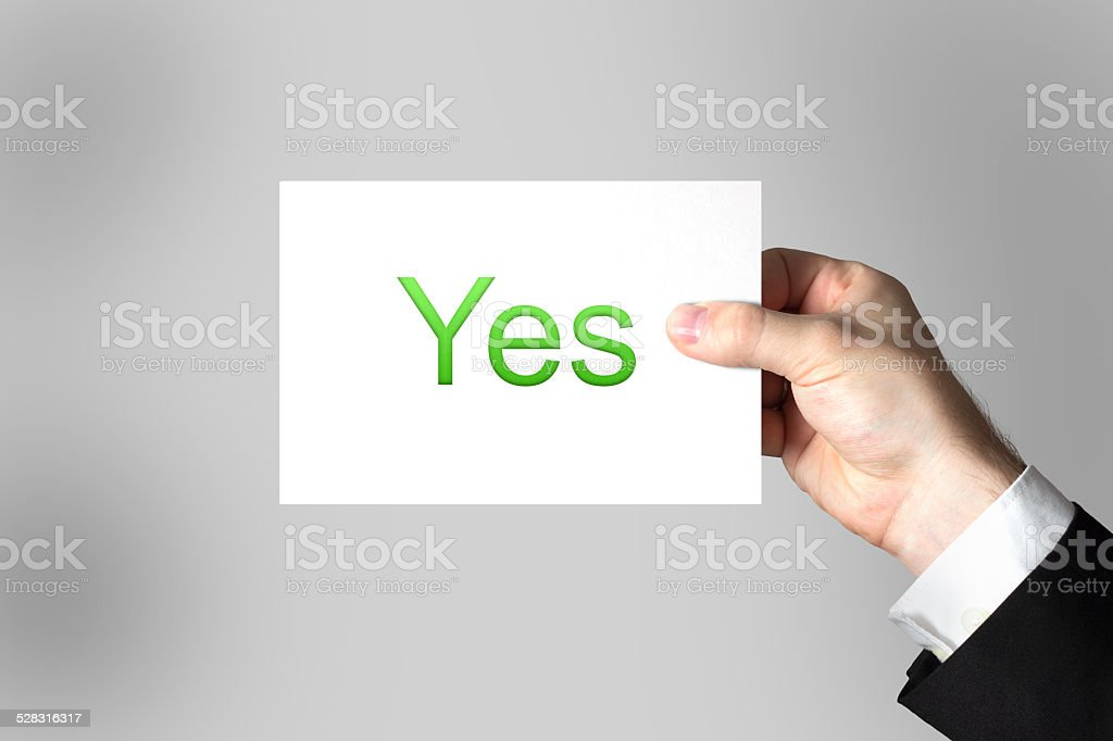 hand holding sign yes stock photo