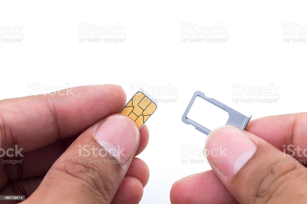 Hand holding sim card ans sim card tray stock photo