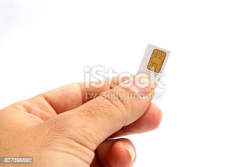 istock Hand holding sim card isolated on white background 627396592