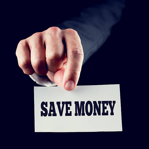 Hand Holding Small Paper with Save Money Texts stock photo