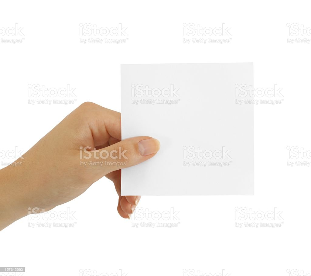 Hand holding small square blank sticky note isolated on white royalty-free stock photo