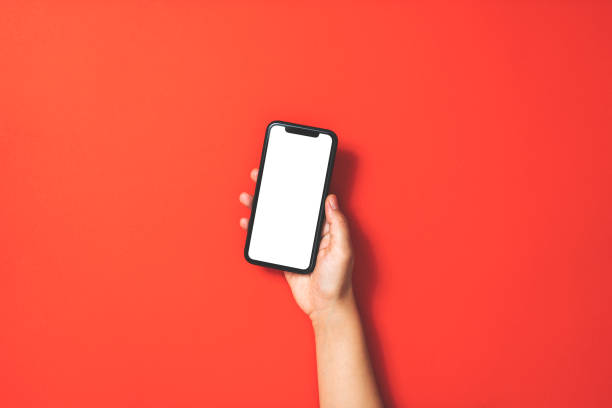 Hand holding smart phone on red background picture id1187668748?b=1&k=6&m=1187668748&s=612x612&w=0&h=z376cnqmkv00gucw5merpv4hwmlw3tqd2vtqlix10bw=