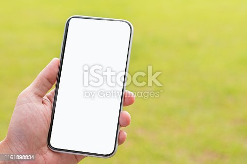 Hand holding smart phone show white screen isolated on green nature background and clipping path on hand and smartphone.