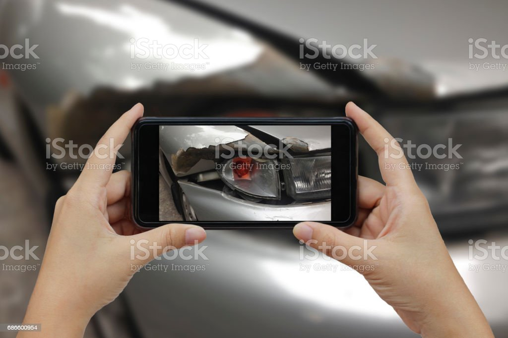 Hand holding smart phone take a photo at The scene of a car crash, car accident for insurance royalty-free stock photo