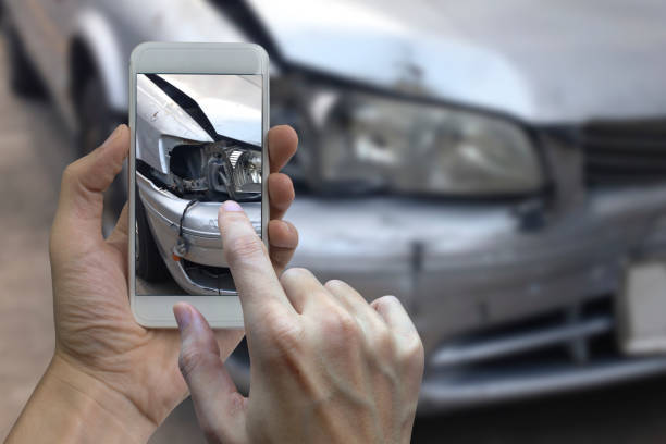hand holding smart phone take a photo at the scene of a car crash, car accident for insurance - dent stock pictures, royalty-free photos & images