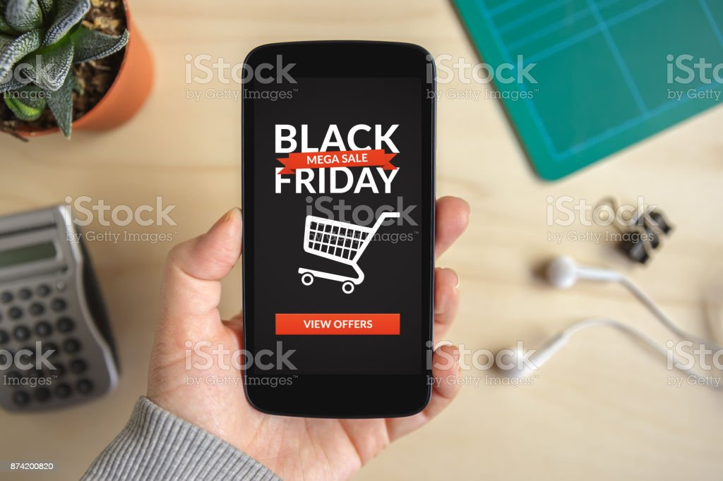 Hand holding smart phone with Black Friday concept on screen stock photo