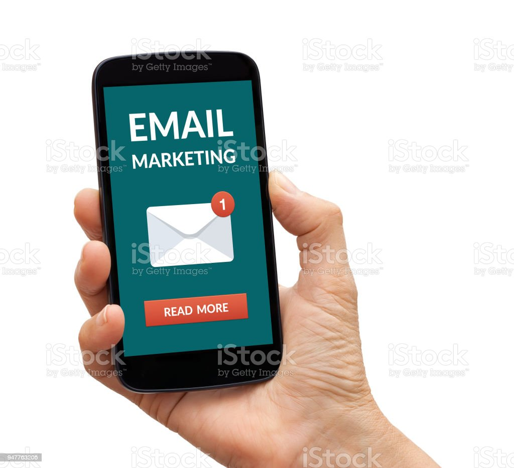 Hand holding smart phone with email marketing concept on screen stock photo