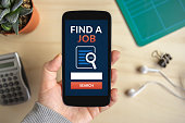 istock Hand holding smart phone with find a job concept on screen 684040578