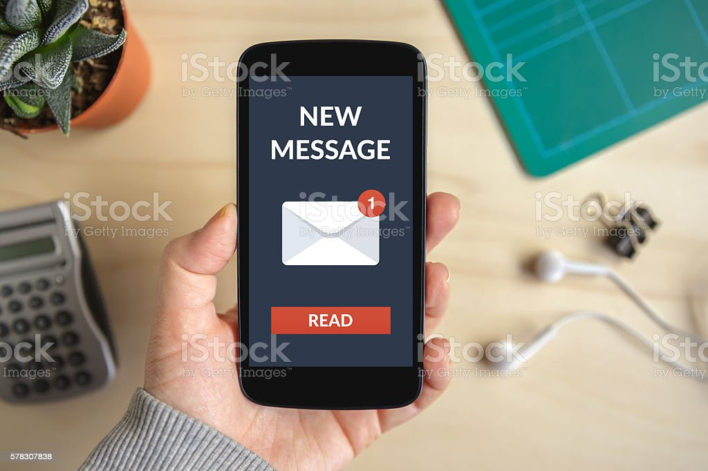 Hand holding smart phone with new message concept on screen stock photo