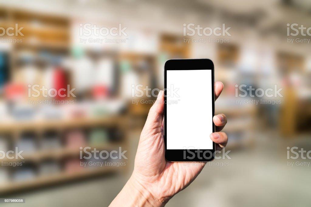 Hand mit Smartphone mit shopping – Foto