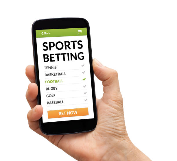 Hand holding smart phone with sports betting concept on screen stock photo