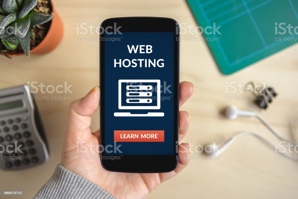 Hand holding smart phone with web hosting concept on screen Hand holding smart phone with web hosting concept on screen. All screen content is designed by me. Flat lay Accessibility Stock Photo