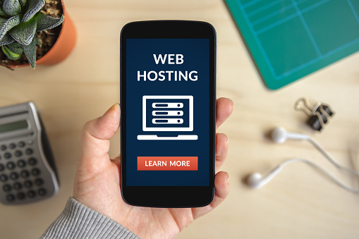 Hand Holding Smart Phone With Web Hosting Concept On Screen Stock Photo - Download Image Now