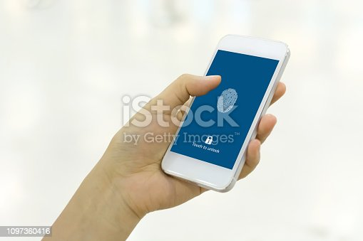 istock Hand holding smartphone and scan fingerprint biometric identity for unlock her mobile phone 1097360416