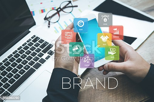 istock Hand holding smartphone and showing Brand concept 666360292
