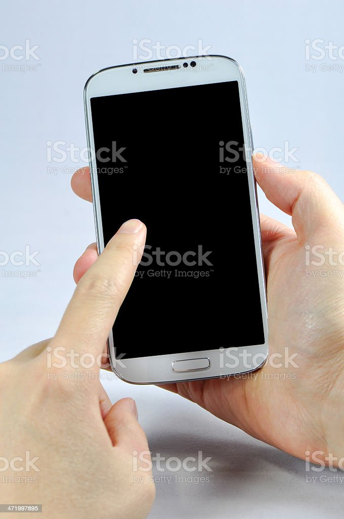 Hand holding smartphone isolated on white royalty-free stock photo